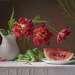 С букетом красных тюльпанов и арбузом