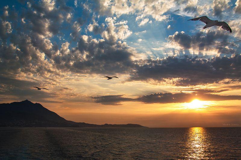 Закат на фоне острова Искьяphoto preview