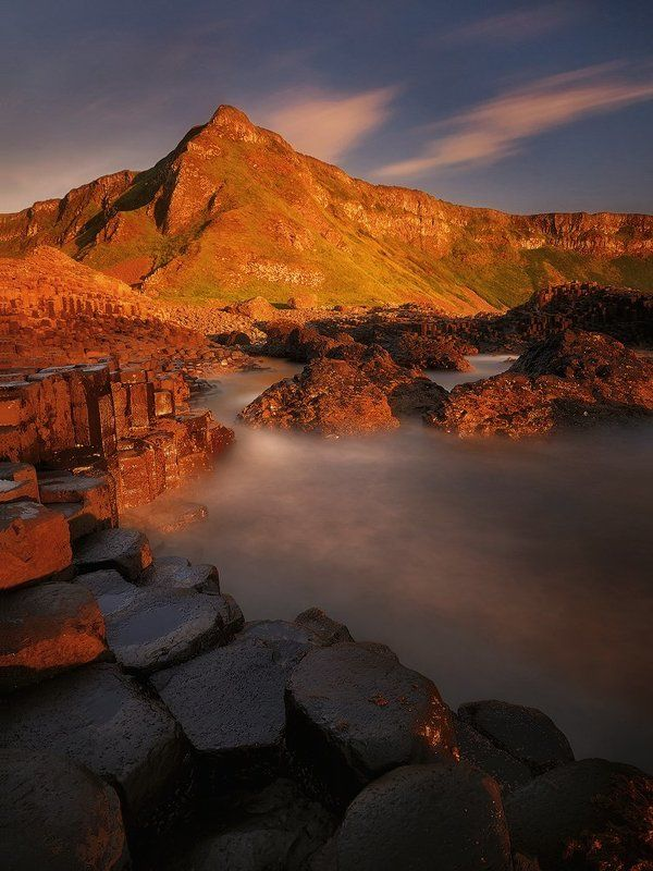 northern ireland, giants causeway, basaltic, sunset, light, fine art, photography, long exposure, nd, nikon, travel, adventure, rgb, seascape, water, rocks, mountains, hills, antrim, bushmills,  A Storm Of Lightphoto preview