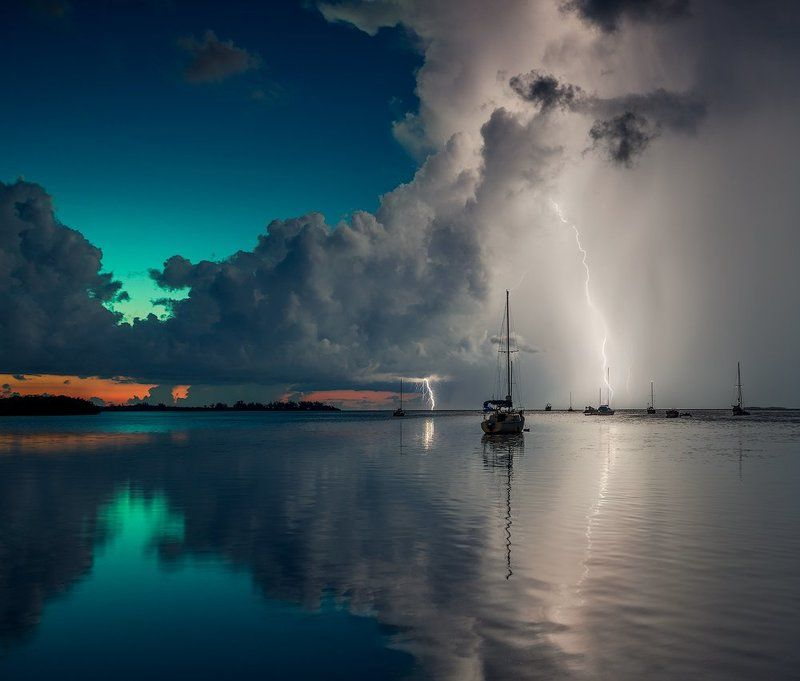 Blue, Boats, Clouds, Lightning, Ocean, Rain, Red, Reflection, Sky, Storm, Summer, Sunset, Water ***photo preview
