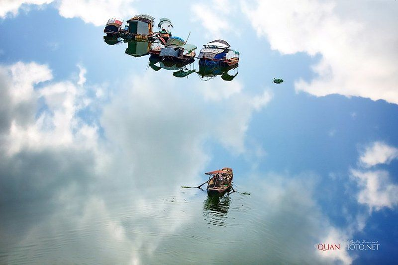 #quanphoto,#landsscape,#reflections,#river,#boats,#fisheman,#clouds,#vietnam Rudderlessphoto preview