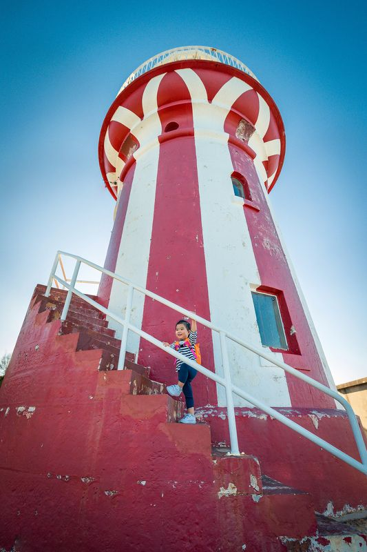 lighthouse, kid, girl, travel, climbing, child, red, blue Celine in the lighthousephoto preview