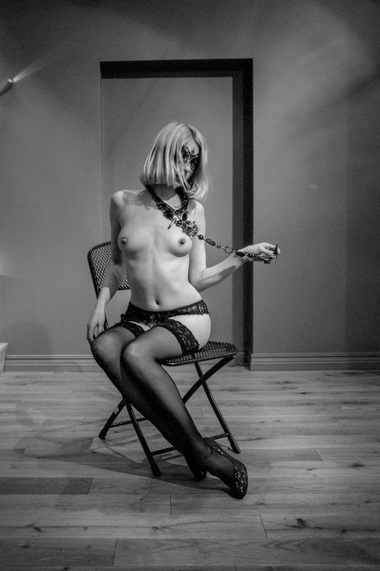 woman, nude, black and white, mixed light, lingerie Woman in maskphoto preview