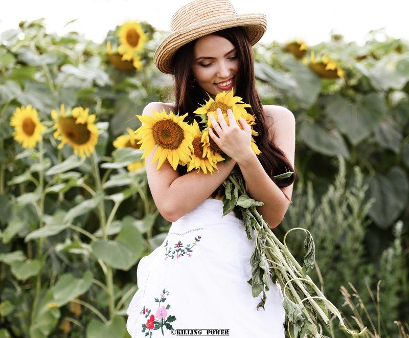 Lady and sunflowersphoto preview