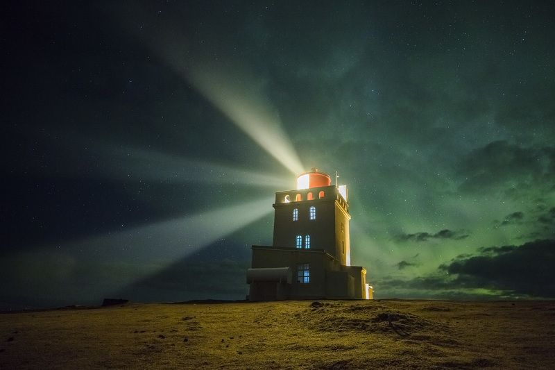 iceland lighthouse aurora northern lights Lighthouse in green clouds. Icelandphoto preview