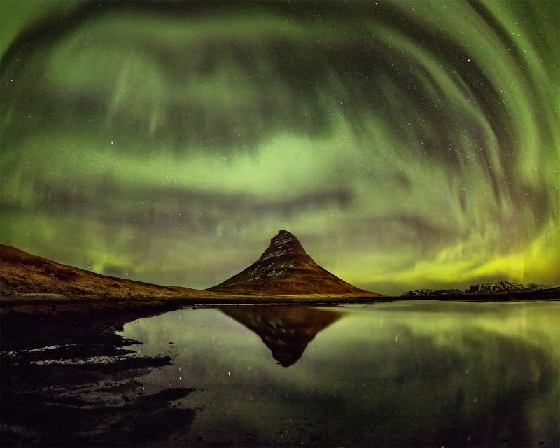 Kirkjufell covered by northern lights.photo preview